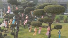 Lampions in bonsai trees of thai temple,Kushinagar,India Stock Footage