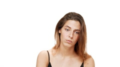 Upset young beautiful girl thinking, listening over white background. Slow Stock Footage