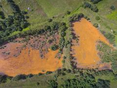 Old sulfuric acid natural tank orange color in south of Poland. Stock Photos