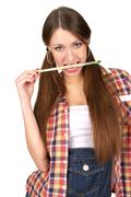 Beautiful young woman with paint brush Stock Photos