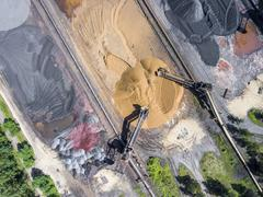 Mining excavator on the bottom surface mine. Brown coal deposits. View from a Stock Photos