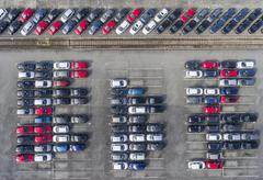 Aerial view lot of vehicles on parking for new car. Kuvituskuvat