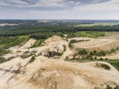 Aerial view of excavator and truck working on the field of sand mine in Polan Stock Photos