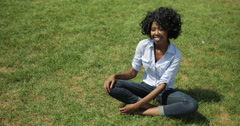 Young adult black woman in city park smile face portrait Stock Footage