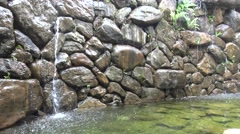 4k artificial waterfall in the middle of the Daan park in Taipei city -Dan Stock Footage