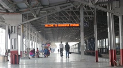 People walking towards train on Railway platform,Gorakhpur,India Stock Footage
