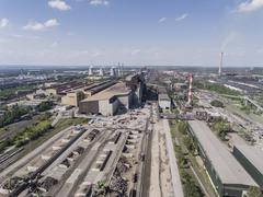 Steel factory with smokestacks at sunny day.Metallurgical plant. steelworks,  Stock Photos