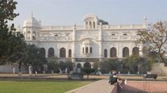 Boys play cricket at Safed Baradari historical landmark,Lucknow,India Stock Footage