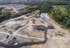 Aerial view over the building materials processing factory. Sand mine. View f Stock Photos