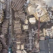 Sawmill. Felled trees, logs stacked in a pile. View from above. Industrial ba Stock Photos