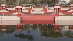 Suraj Kund sacred water pond with reflection,Lucknow,India Stock Footage