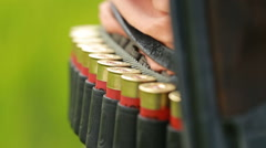 Hunting ammunition bandolier and close-up Stock Footage