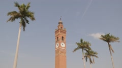 Clock tower and palm trees,Lucknow,India Stock Footage