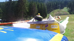 New adrenaline attraction, summer tubing with high jump Stock Footage