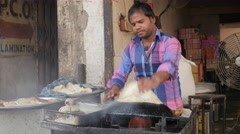Man makes traditional roti bread,Lucknow,India Stock Footage
