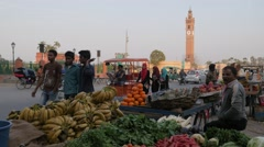 Fruit seller and clock tower,Lucknow,India Stock Footage