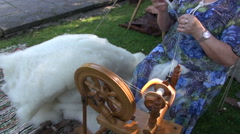 Woman spinning wool in medieval fair Stock Footage