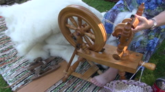 Respectable age woman using spinning wheel Stock Footage