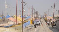 Road through tent camp,Allahabad,Kumbh Mela,India Stock Footage
