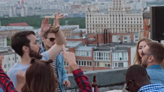 Clubbers Waving Their Arms at Day Rooftop Party Stock Footage
