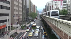 4K of an elevated train travels over a line of traffic during in taipei -Dan Stock Footage
