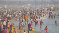 Pilgrims bathing in holy river at Sangam,Allahabad,Kumbh Mela,India Stock Footage