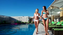 Crazy girl jumping into the pool, spa Stock Footage