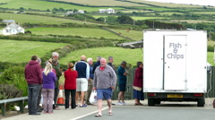 Queue for fish and chips, Cornwall, England. Stock Footage