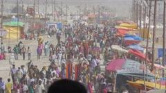 Crowds walking around Sangam with stalls,Allahabad,Kumbh Mela,India Stock Footage