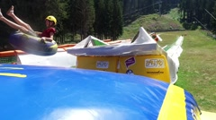 Summer Tubing atraction Park with jump replaces winter snow sliding Stock Footage