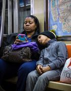 Black woman with a child in New York City subway Kuvituskuvat