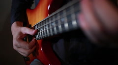 Bass guitar player close up playing virtuoso bass with fingers and slap Stock Footage
