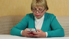 Woman with smartphone. Woman types sms on mobile phone Stock Footage