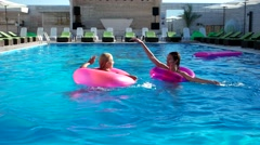 Girls, fool around in the pool on a summer Floating Ring Stock Footage
