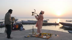 Hindu priest performing morning puja at Ganges,Varanasi,India Arkistovideo