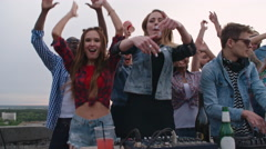 Carefree Young People Partying Nonstop on Rooftop Stock Footage