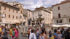 Assisi Fountain and medieval houses, Umbria, Italy Stock Footage