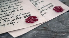 Old papers lies on the table. Antique letters with official heraldic stamps Stock Footage