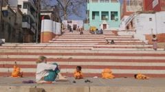 Kids doing yoga with teacher on ghats,Varanasi,India Stock Footage