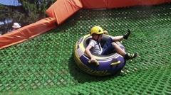 Tourist enjoy having fun at summer Tubing Park Stock Footage