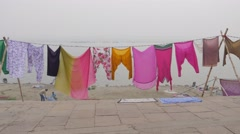 Clothes drying on ghats,Varanasi,India Stock Footage