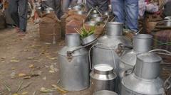 Indian milk cans on street,Varanasi,India Stock Footage