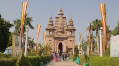 Pilgrims walking towards Mulgandha Kuti Vihar,Sarnath,India Stock Footage