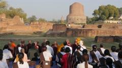Pilgrims praying in towards Dhamekh Stupa,Sarnath,India Stock Footage