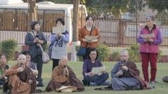 International monks and pilgrims praying,Sarnath,India Stock Footage