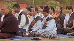 Buddhist pilgrims meditating at Dhamekh Stupa,Sarnath,India Stock Footage