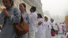 Female pilgrims walking around temple,BodhGaya,Mahabodhi Temple Complex,India Stock Footage