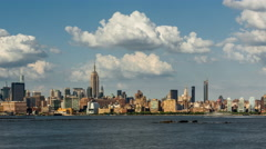 New York Midtown skyscrapers, West Village and Hudson River with passing clouds Stock Footage