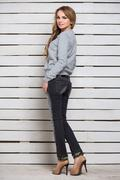 Pretty woman in gray hoody Stock Photos