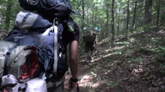 Backpackers on Trail Over The Shoulder Slow Motion Stock Footage